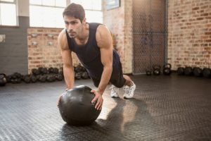 Push ups with a medball